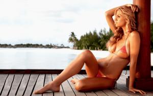 woman in bikini sitting on deck