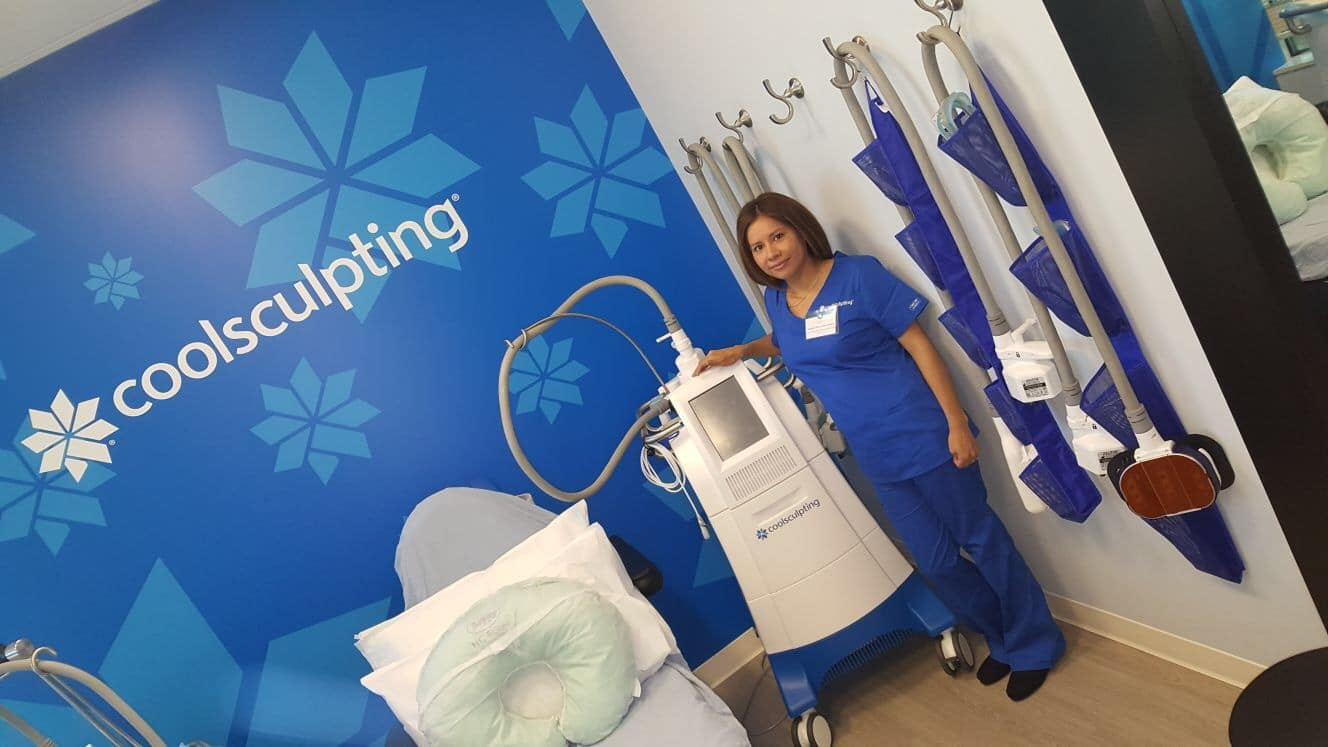 CoolSculpting technician with CoolSculpting machine.